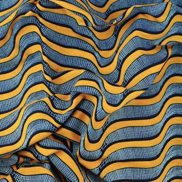 tissu wax africain hitarget motif Okavango jaune et bleu © Eyrelles Tissus