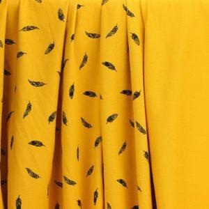 Tissu Jersey de coton Plumes Jaune moutarde © Eyrelles Tissus