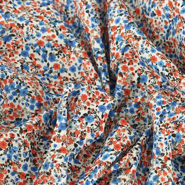 """Tissu coton imprimé """"Libertyne - Bleu et Orange"""" © Eyrelles Tissus"""