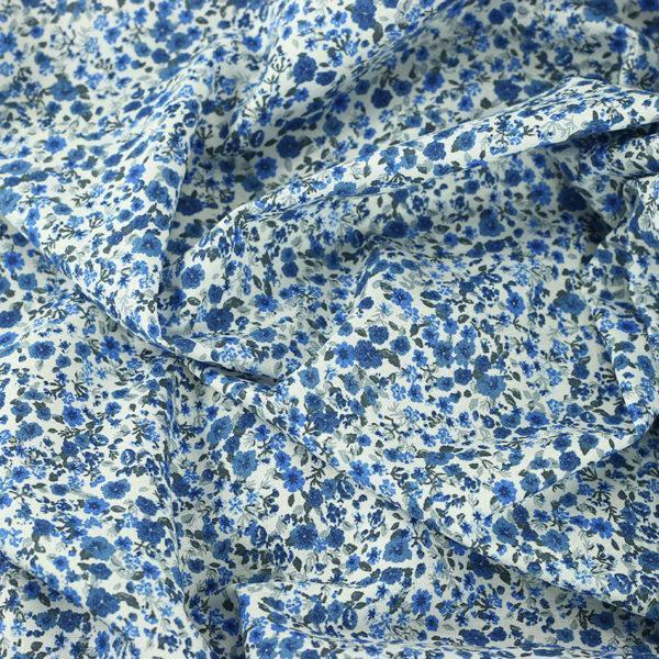 "Tissu coton imprimé ""Libertyne - Bleu"" © Eyrelles Tissus"