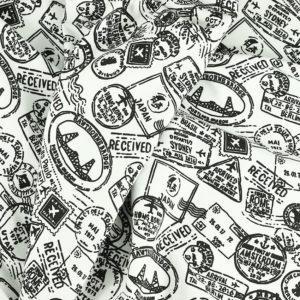Tissus Jersey coton imprimé oeko tex timbres blanc © Eyrelles Tissus